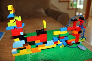 Vikram's Ship - he used yarn and paper with Lego