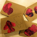 Fingerpaint. Cut Shapes and then Glue on Cards.