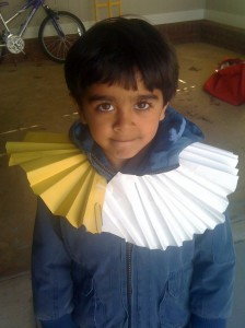 Kabir wearing a ruff made of paper like the Europeans