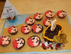 Pirate cupcake and treasure chest cake