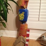 Arjun's wooden plank house with totem pole