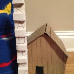 Kabir's wooden plank house with totem pole